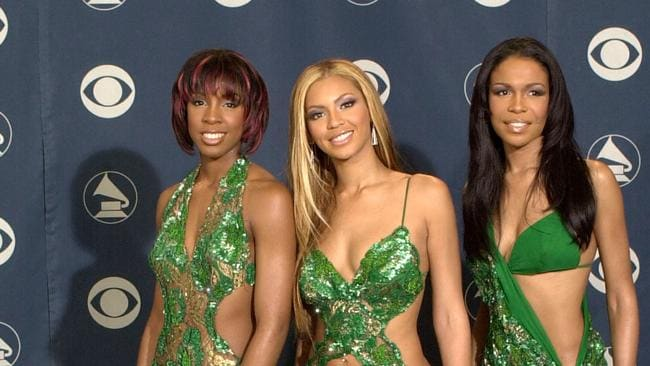 Michelle Williams (right) with Beyonce Knowles and Kelly Rowland. Photo: David McNew