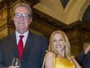 At an Australian embassy in London April 17 off the record. Alexander Downer with Kylie Minogue.
