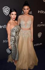 TV personalities Kourtney Kardashian (L) and Kylie Jenner attend The 2016 InStyle And Warner Bros. 73rd Annual Golden Globe Awards Post-Party at The Beverly Hilton Hotel on January 10, 2016 in Beverly Hills, California. (Photo by Jason Merritt/Getty Images for InStyle)