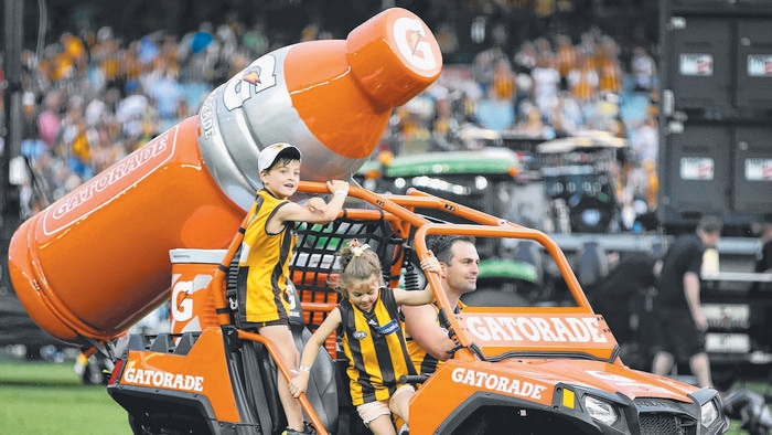 during the 2015 AFL Grand Final between the Hawthorn Hawks and the West Coast Eagles played at the Melbourne Cricket Ground on Saturday, October 3, 2015, in Melbourne, Victoria, Australia. AFLGF2015 MCG. Brian Lake of Hawthorn drives a Gatorade buggy around the ground with his kids. Picture: David Caird.