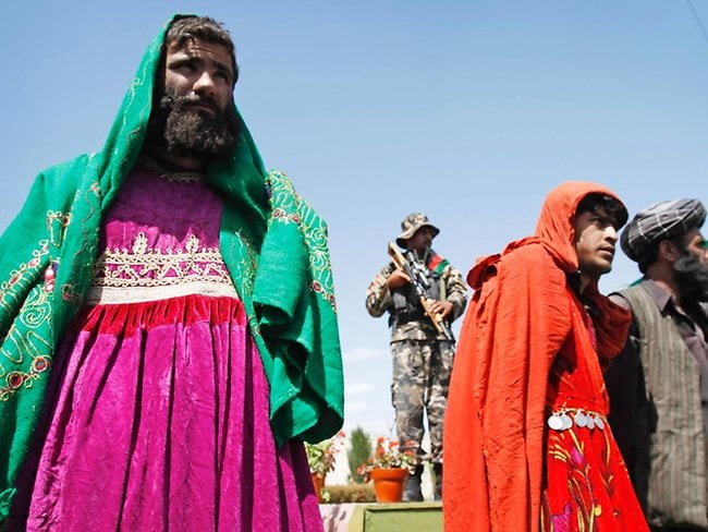 Pink is so not my colour. Taliban insurgents were arrested east of Kabul yesterday wearing women's dresses. Picture: AP
