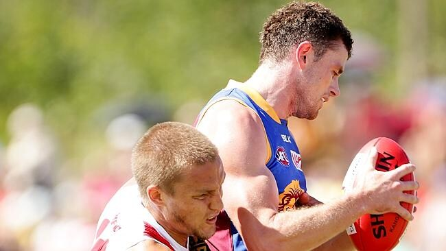 Pearce Hanley tries to bust through a Sam Reid tackle. Picture: Mark Calleja