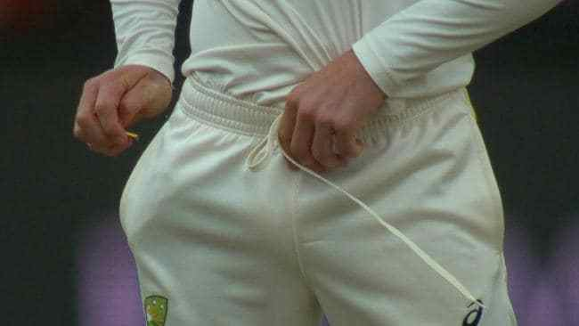 3. After talking to Handscomb, Bancroft attempts to cover up his dirty work by putting the yellow tape down the front of his pants - supposedly safe from prying eyes. This is all captured on camera.