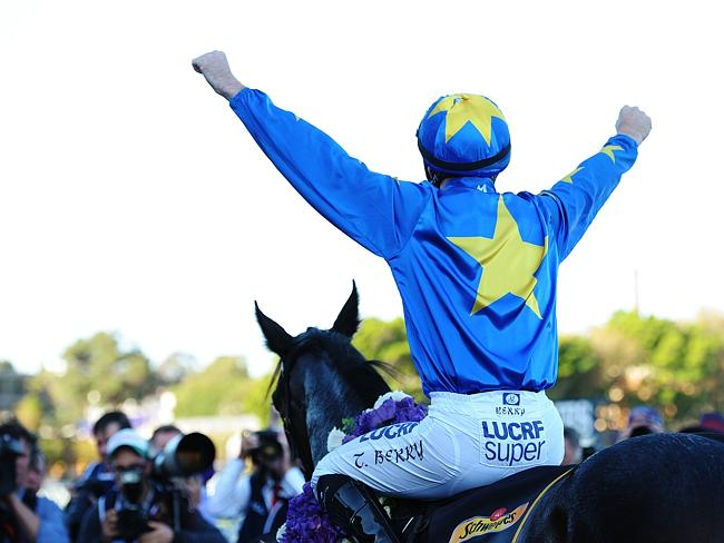 An emotional Tommy Berry celebrates winning the Sydney Cup aboard The Offer during The Championships.