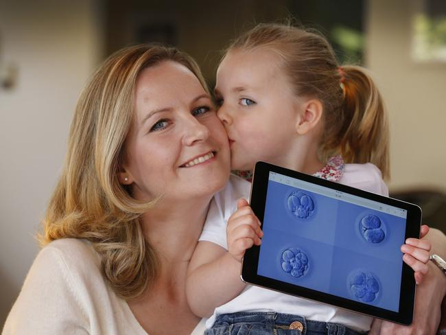Lucy Williams and her daughter Emily 4, hold an iPad with 4 stages of the cells dividing. Emily was conceived through IVF. Picture: David Caird