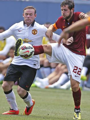 AS Roma's Mattia Destro, with Wayne Rooney.