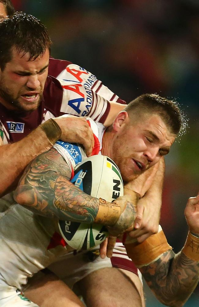 Josh Dugan is tackled by Brenton Lawrence.