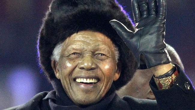 Nelson Mandela waves as he arrives to attend the 2010 FIFA World Cup football in Johannesburg.