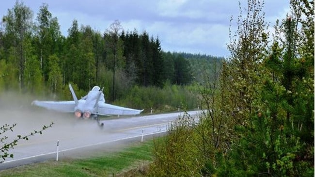 A Finnish Defence Force Jet landing on a rural road. Picture: Finnish Defence Force.