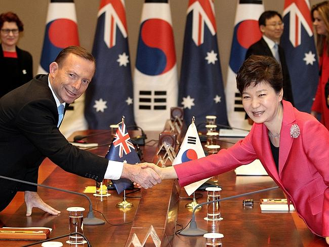 It's been a good week ... Prime Minister Tony Abbott shakes hands with South Korean Presi