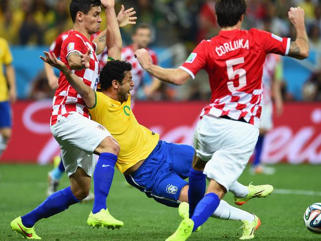 Right said Fred. The Brazilian successfully milks a very cynical penalty in the 2014 FIFA World Cup Brazil Group A match between Brazil and Croatia at Arena de Sao Paulo. Picture: Buda Mendes/Getty Images