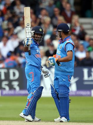 India's Ambati Rayudu, left, celebrates reaching his half century. Picture: Simon Cooper