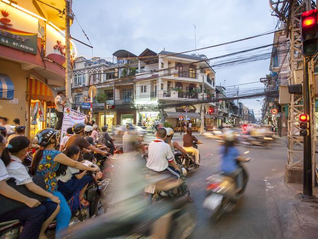 Navigating roads filled with motorbikes is one of the challenges for visitors to Ho Chi Minh City (Saigon).
