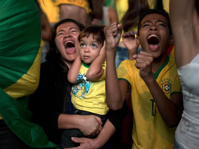 A young Brazil fan watches the quarterfinal between Brazil and Colombia.