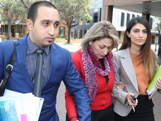 Payam's girlfriend Neda Esmaeili (centre) is supported on her way to court. Picture: Ross Schultz