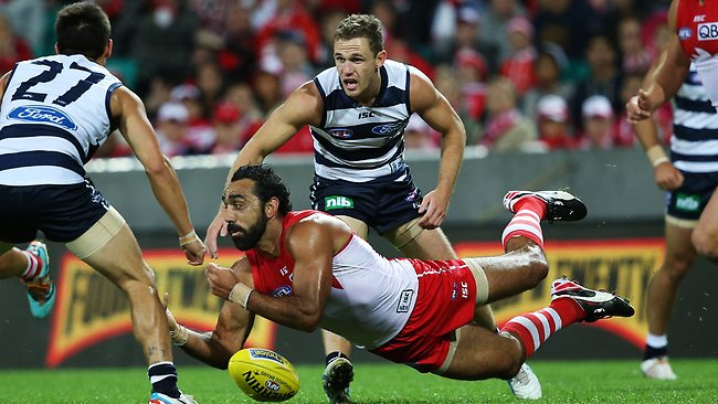 AFL - Sydney Swans v Geelong Cats at the SCG. Sydney's Adam Goodes gets out a diving handball ahead of the Cats Joel Selwood. Picture: Hillyard Philip