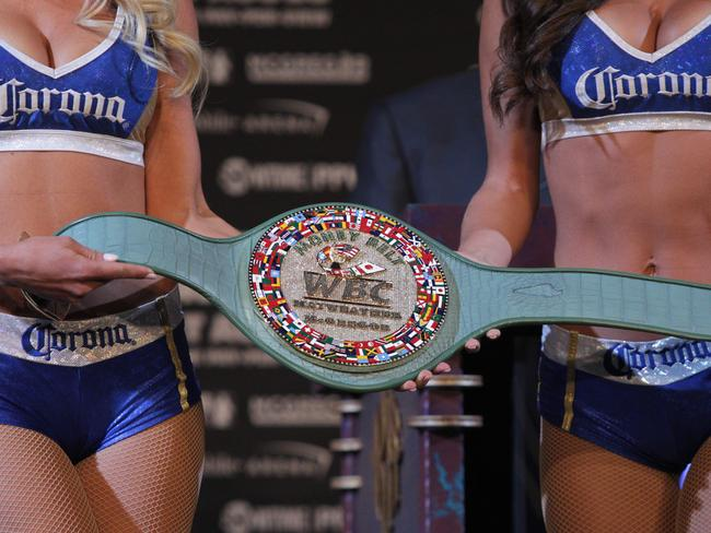The victor's belt is displayed during a press conference with boxer Floyd Mayweather Jr. and MMA fighter Connor Mcgregor.