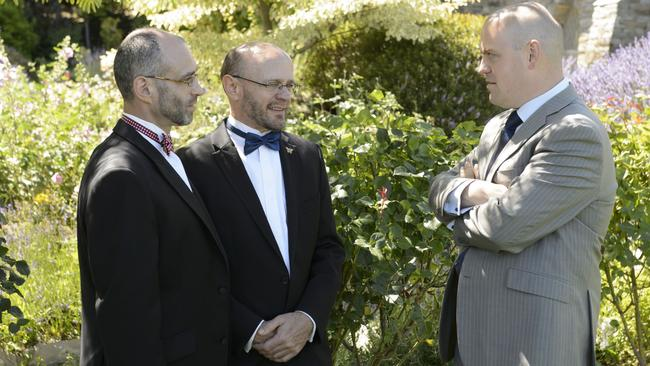 Diametrically opposed ... Athiest gay couple and Anglican minister live with each other ... also. Picture: Supplied