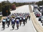 The peloton travels along the Port River Expressway. Picture Sarah Reed