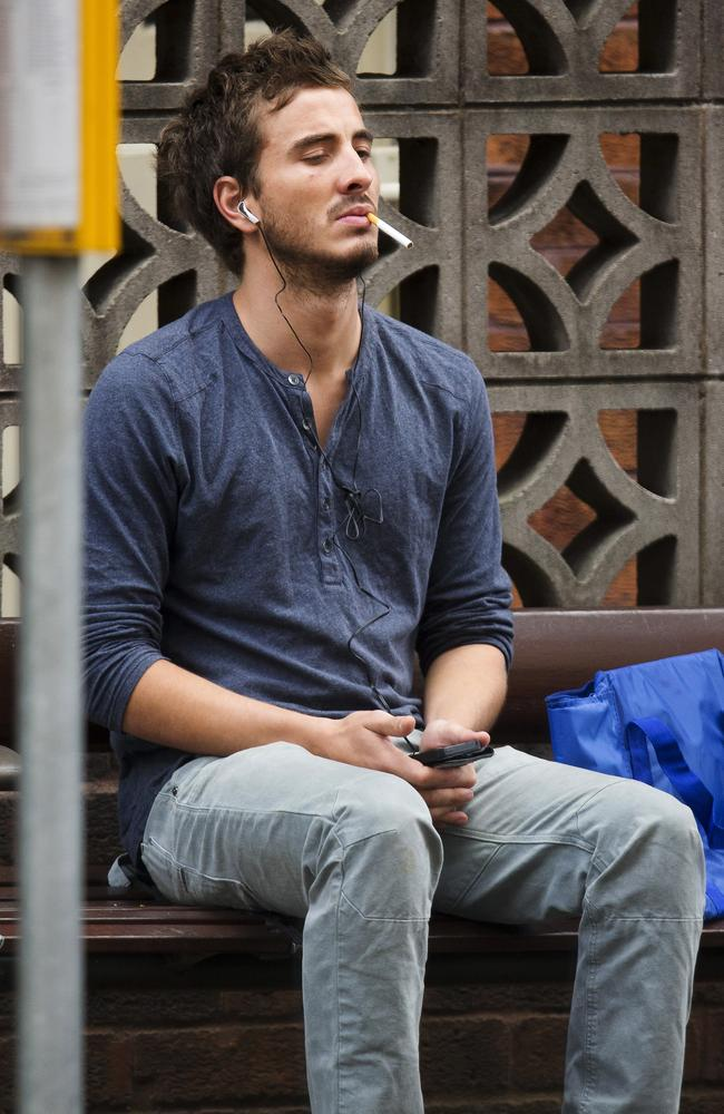 Ryan Corr seen smoking at bus stop in Sydney's Kings Cross in May 2013. Picture: Diimex