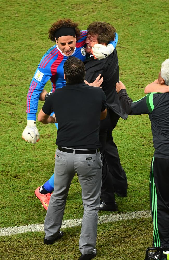 Guillermo Ochoa of Mexico celebrates with Herrera.