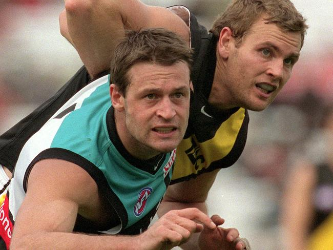 Power ruckman Matthew Primus tussles with Greg Stafford in 2002.