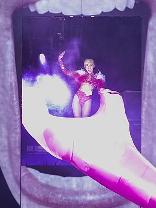 She finally appears ... Miley Cyrus waves to her fans. Picture: Phillip Chin/Getty Images