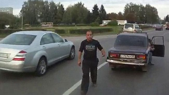 The angry driver hops out to confront Volkov, but so far, he's had the law on his side. Picture: Alexei Volkov, via YouTube