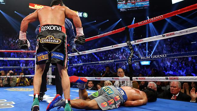 Manny Pacquiao lays face down on the mat after being knocked out in the sixth round by Juan Manuel Marquez.