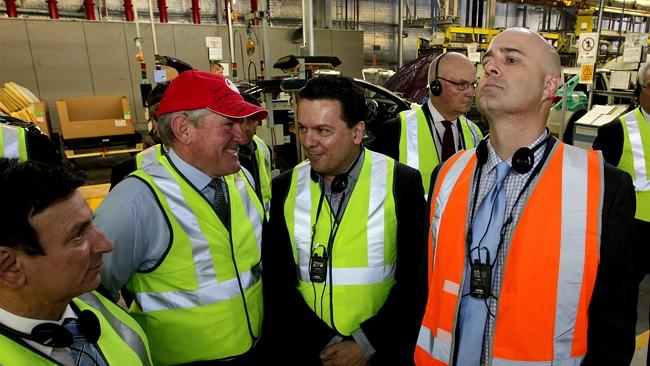 Tony Zappa, Federal Industries Minister Ian Macfarlane, Senator Nick Xenophon and Mike Devereux, Holden Chairman and Managing Director at the Holden factory in Elizabeth, South Australia.