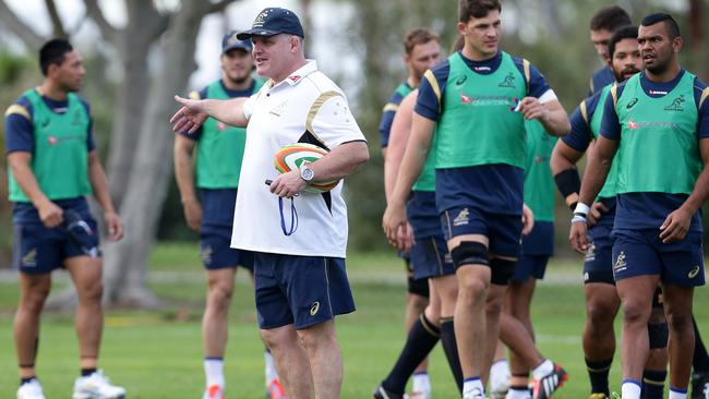 Coach Ewen McKenzie shows the way at a Wallabies training session this week.