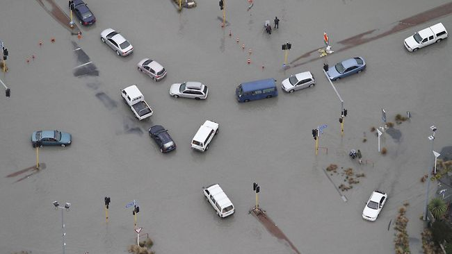 Liquefaction after the earthquake has flooded streets in Bexley, Christchurch. Picture: Mark Mitchell, New Zealand Herald