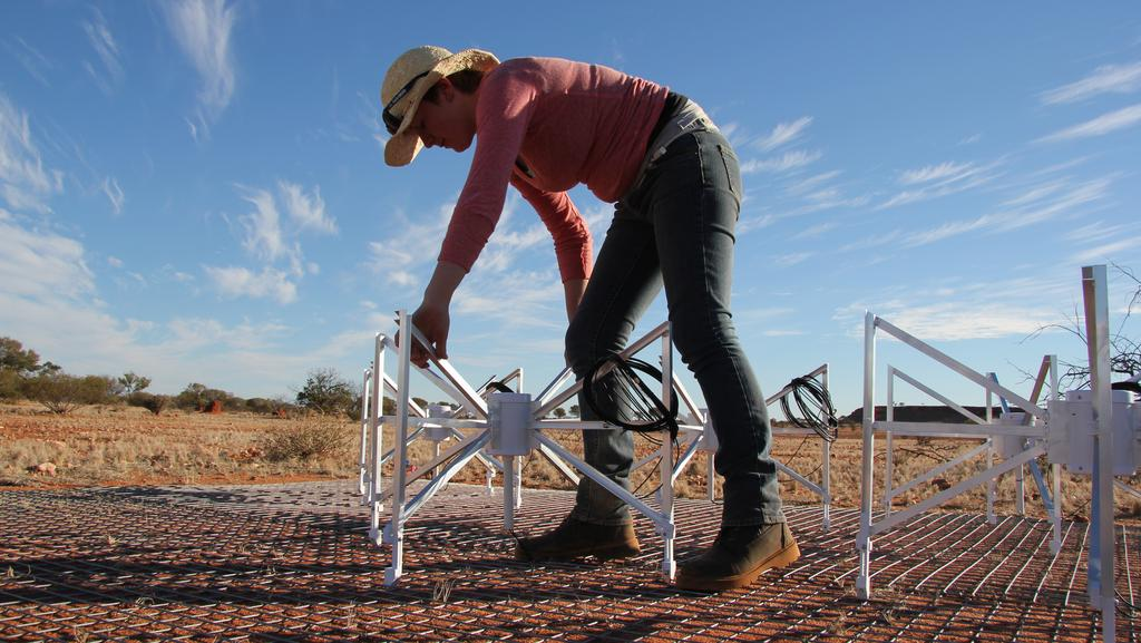 Curtin University undergraduate Kimberly Steele working on the Murchison Widefield Array telescope.