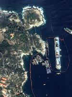 This photo provided by Astrium shows the upright Costa Concordia off Giglio Island, Italy, Tuesday, Sept.17, 2013 . Engineers declared success on Tuesday, Sept.17, 2013 as the Costa Concordia cruise ship was pulled completely upright during an unprecedented, 19-hour operation to wrench it from its side where it capsized last year off Tuscany. (AP Photo/CNES/Distribution Astrium Services/Spot Image)