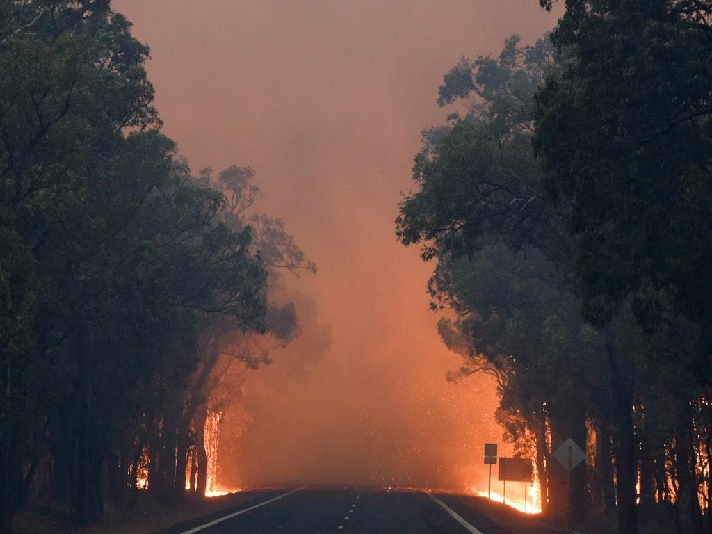 A supplied image obtained Saturday, Jan. 9, 2015 of a bushfire at Yarloop, 120 km south of Perth in West Australia. A major bushfire in western Australia destroyed hundreds of homes and left 3 people unaccounted for as it tore through a small rural town south of Perth, emergency officials said on Friday. (AAP Image/Department of Fire and Emergency Services)