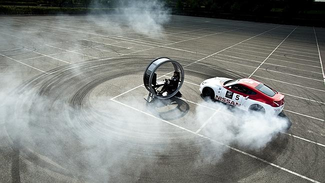 That's off putting. Nissan 370Z doing doughnuts around a Sony PlayStation gaming pod