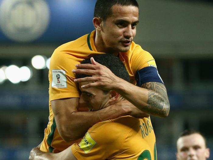Socceroo striker Tim Cahill (top) congratulates Tom Rogic on scoring against Jordan in Sydney.
