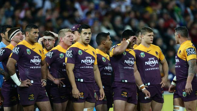 Broncos react after a Warriors try.