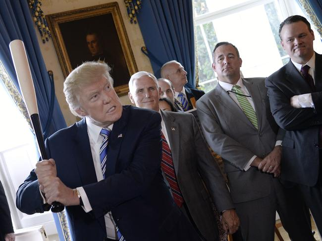 President Donald Trump swings a baseball bat during a 'Made in America' product showcase event at the White House. Picture: AFP / Olivier Douliery