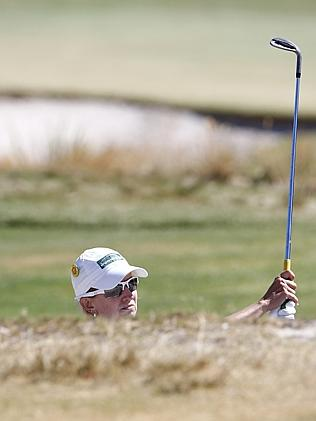 Webb plays out of a fairway bunker.