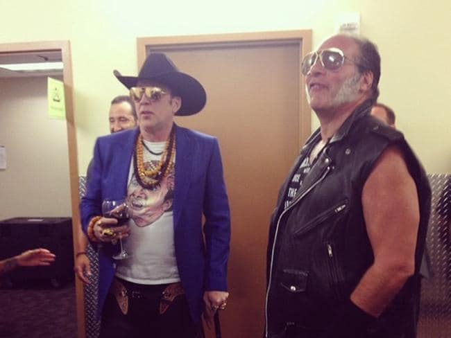 Ultimate self-flattery ... Nicolas Cage wearing a T-shirt of himself, pictured with Andrew Dice Clay.