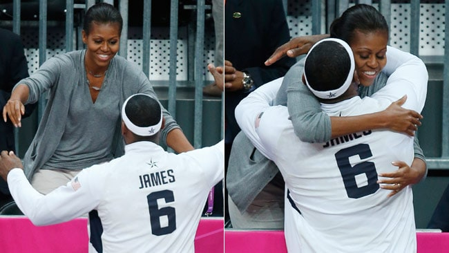 Mrs Obama handed out hugs to the rest of the US team, and even planted a kiss on Bryant's teammate LeBron James. Pictures: Getty Images