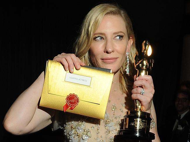 Cate Blanchett poses with her Oscar at the Governor's Ball following the 86th Academy Awards.