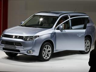 The new Mitsubishi Outlander PHEV (Plug-in Hybrid Vehicle) on display during the press day at the Paris Auto Show, France, Thursday, Sept. 27, 2012. The Paris Auto Show will open its gates to the public from Sept. 29 to Oct. 14. (AP Photo/Michel Euler)