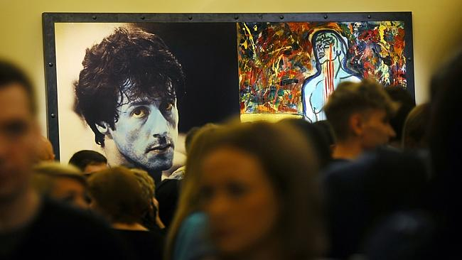 Visitors stand in front of the painting 'Champion Due' by Sylvester Stallone during the art exhibition 'Sylvester Stallone Painting From 1975 Until Today' at the Russian Museum in Saint Petersburg in October last year.