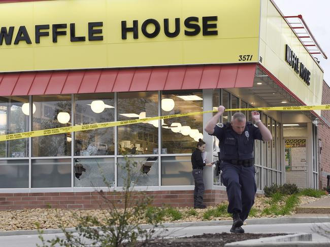 Law enforcement officials work the scene of the fatal shooting. Picture: AP