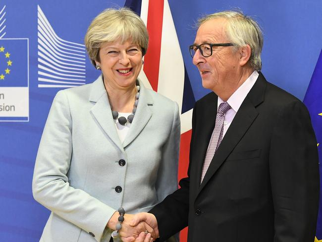 British Prime Minister Theresa May welcomed by European Commission Jean-Claude Juncker at European Commission in Brussels. Picture: AFP