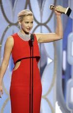 "Jennifer Lawrence accepts the award for Best Actress - Motion Picture, Comedy for ""Joy"" onstage during the 73rd Annual Golden Globe Awards at The Beverly Hilton Hotel on January 10, 2016 in Beverly Hills, California. (Photo by Paul Drinkwater/NBCUniversal via Getty Images)"