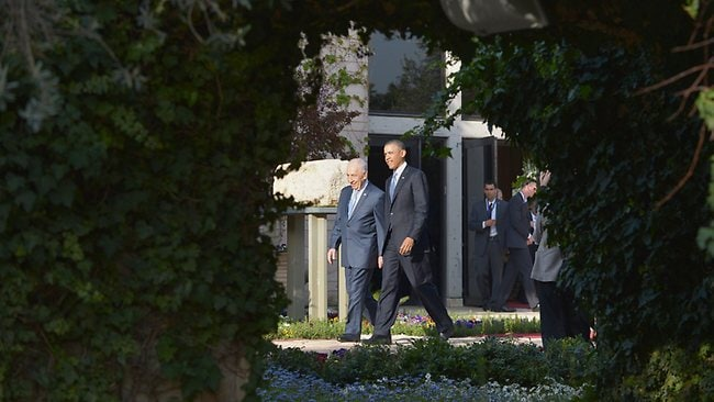 US President Barack Obama and Israeli President Shimon Peres walk through the garden at the latter's residence in Jerusalem. Picture: AFP