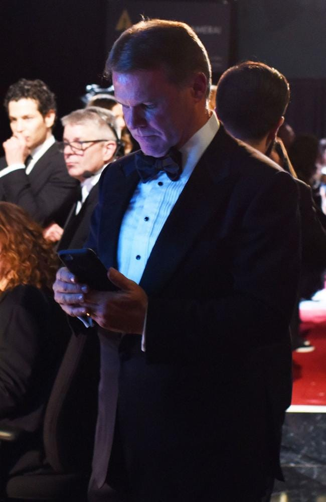 This previously unseen image of PwC accountant Brian Cullinan tweeting backstage ... a move that led to the Best Picture debacle. Picture: Splash
